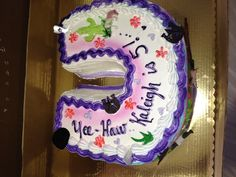 Horse shoe shaped cake for a cowgirl party