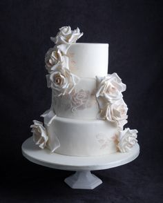 Gorgeous large roses adorn a classic wedding cake.  Accented with a shimmering rose detail.  For more information visit www.cakeglam.com rose adorn, shimmer rose, larg rose, rose detail