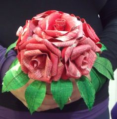 Rose Bouquet made from the pages of a French novel...by Megan Finley from Offbeatbride.com. Rock. I may just do this. Maybe this could go with the Summer Reading Program. Recycled book craft.