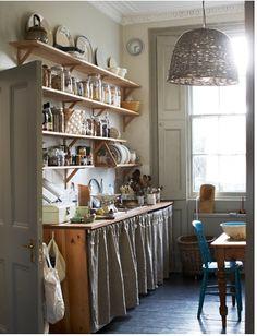 open shelves.  skirted lower cabinet