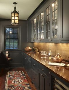 Tone on tone charcoal cabinets/butler's pantry - walls and wood trim painted out the same color as the cabinets. Copper counter tops. This is gorgeous!!!
