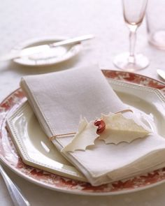 Holly Napkin Holders  Dress up the dinner table with napkin holders made from felt holly leaves and a jingle bell.