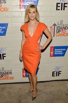Reese Witherspoon cleavage in a low-cut orange and white Roland Mouret dress. Had no idea she had such gorgeous curves.