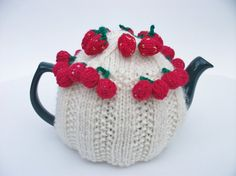 Knitted tea cosy cream with strawberries and by madmumknits, £15.00