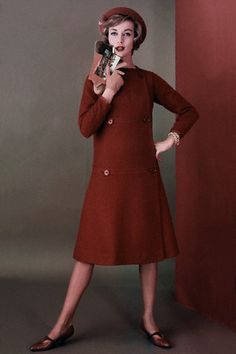 August 1958    Model is wearing a sleeveless, tweed doublet over a furry, wool dress, both by Mr. Mort Sportswear with calf pumps by I. Miller.