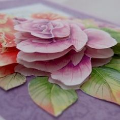 Rose flower layered using the paper tole or three dimensional layering technique shown in the tutorial on the page.