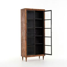 Crafted from reclaimed pine, our Alexa Cabinet imparts sophistication to naturalist style with its gently tapered legs and glass doors. With adjustable shelving and a door cabinet, it has plenty of storage to keep rooms clutter-free.