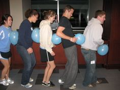 Team Building With Balloons - A fun way to get kids interactive and using balloons to connect them.  Kids will love it and have a great laugh at the activity.