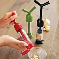 The Chef'n Garlic Machine Garlic Press offers garlic prep and storage in one gadget.  (gadgets, ideas, inventions, cool, fun, amazing, new, interesting, product, design, clever, practical, useful, gizmo, brilliant, genius, kitchen, home)