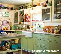 The collection of teapots, green cabinets and apron-front sink blend well in this vintage farmhouse-style kitchen. (Photographed by BlackstoneEdge.com and styled by Donna Pizzi.)
