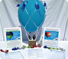 Hot Air Balloon Ride - Silent auction table display for balloon ride packages in 200 cities across the country. Supplier handles everything including providing auction display kit. Details in article on www.FundraiserHelp.com Add to your auction with no upfront cost.