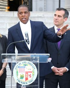 Los Angeles Mayor Eric Garcetti proudly looks on as Jay Z announces he's bringing his Made In America music festival to the city during Labor Day weekend on April 16, 2014 at LA City Hall.
