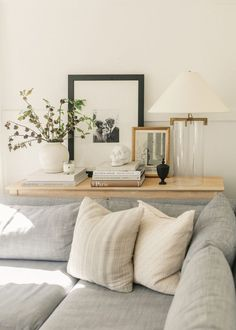 light gray sectional sofa // light wash wood cabinet // simple living room design
