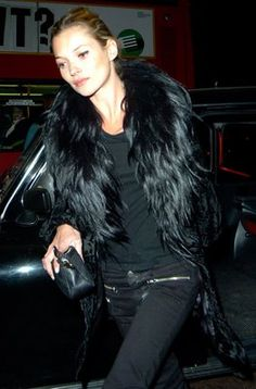 Great rocker chic look. Monochromatic black makes the fur look effortless.