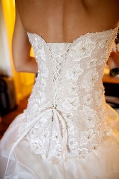 Love the back of this wedding dress, and the flower pattern! My dress also has the corset back, but it is not patterned.