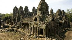 The Bayon temple at the famous temple area of Angkor Archeological Park on Dec. 4, 2008, in Siem Reap, Cambodia. (Ian Walton/Getty Images) ancient histori, bayon templ, beauti place, old mansions, famous templ, angkor wat, cambodia, country, ancient civil