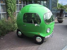 it reminds me of the little apple car the inch worm drives in the Richard Scarry books :D