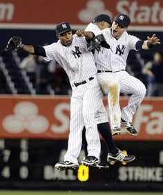 GAME 32: Friday, May 11, 2012 - New York Yankees' Dewayne Wise, left, celebrates with Nick Swisher, right, and Curtis Granderson, center, after a baseball game against the Seattle Mariners in New York. The Yankees won 6-2. (AP Photo/Frank Franklin II)