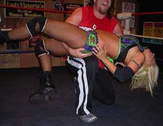 Mixed wrestling backbreaker