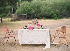 boho lace tablecloth + industrial chairs