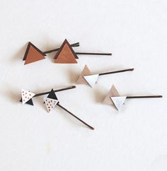 These wooden triangle bobby pins are made easily from sheets of birch plywood you can buy at any crafts store.