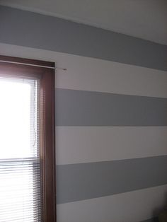 Easily paint event wide horizontal stripes in any room with tips on measuring, taping, preventing paint bleed and more.