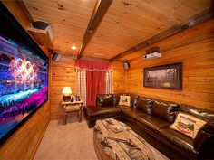 "Black Bear Lodge - Private Wooded Mountain View - This 1 bedroom cabin is pure luxury! The home theater room is almost to big for this size of a cabin. 92"" big screen with a JBL Surround Sound System!"