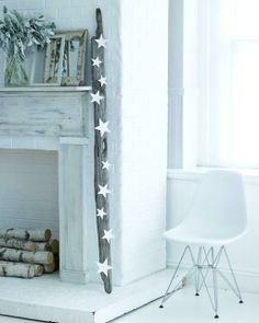 Driftwood Mantle- a large piece of driftwood with white paper stars glued to it