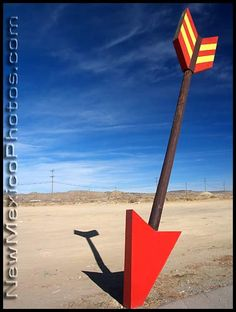 One of a number of large arrows surrounding a Route 66 gas station and tourist shop in Gallup, New Mexico.