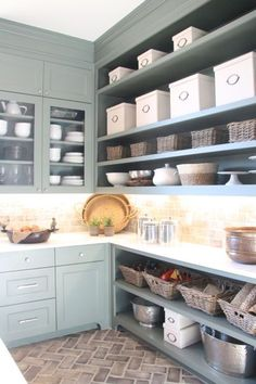 love the color and simplicity of the cabinets in this kitchen.  would be nice for laundry or craft room