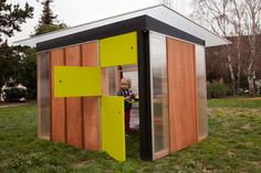 This adorable outdoor playhouse could double as a greenhouse when the kids outgrow it.