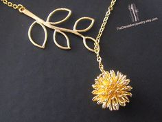 Branch and dandelion lariat by Thedandelionjewelry, $21.00