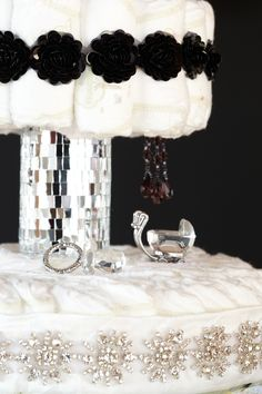 Bling Baby Diaper Cake. Four-tiered diaper cake with 100 HUGGIES® Pure & Natural Diapers featuring glamorous mirror and rhinestone accents.