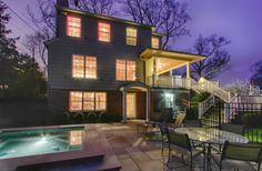 Stunning twilight image of a classic center hall colonial with hot tub for 20 in back yard! www.1Sinclair.com listed by @Towne Realty Group