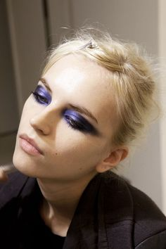 Perfect makeup combo--Deep purple eye (tip: apply eyeshadow in mask like fashion concentrating on the inner eye and bringing the wing tip past the brow)and nude smooch