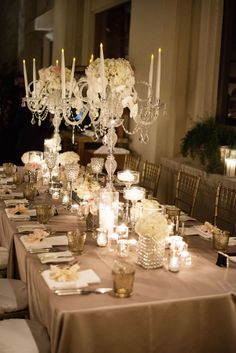 Four Seasons Las Vegas Wedding. Table Decor by Naakiti Floral. Crystal candelabra. Candles. Orchids. Roses