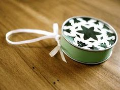 Save those frozen juice containers for an eco-friendly ornament! This Christmas craft idea is a great way to trim your trash. If you want to go green this year, make a Frozen Juice Container Gift Box Ornament.