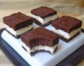 Layered Oreo Fudge tastes and looks like an Oreo cookie! Cookie crumbs are used in the fudge base, and the stripe of white vanilla filling in the middle completes their resemblance to the iconic cookie. You can customize your Oreo Fudge by using flavored cookie crumbs, or adding different extracts like almond or mint to the fudge base.