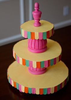 DIY Cupcake Stand TUTORIAL    NOTE:  Can use precut rounds or thick cardboard rounds.  Use large craft sticks or tongue depressors to quicken the project!    Hopscotch Studios Designs: