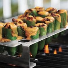 Grilled Jalapeno Poppers    18 jalapeños (larger straight ones work best)  6 oz. sharp cheddar or other cheese, cut into 18 sticks that will fit inside the jalapeños  6 thin slices smoked bacon, each cut crosswise into thirds  18 smoked almonds (optional)