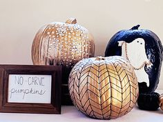 Halloween inspiration Black and gold painted pumpkins