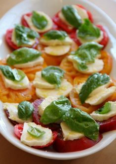 Heirloom Caprese Salad with a secret ingredient!   ShockinglyDelicious.com  #capresesalad #summersalad #heirloomtomatoes #basil #freshmozzarella