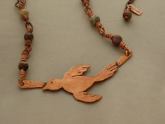 Artisan copper bird necklace, one of a kind hand cut bird in pure copper with wire wrapped jasper stones in the colors of nature. Stamped with my makers mark. by JoDeneMoneuseJewelry