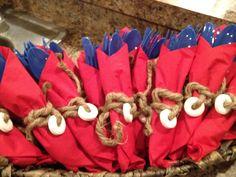 Napkins I made for nautical shower. Blue silverware, red napkin, twine & a lifesaver. Easy & a big hit!