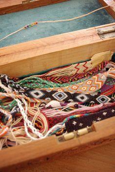 box of string bracelets