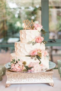 gorgeous white wedding cake with pink floral decor