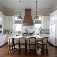 white kitchen + copper hood