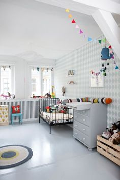 bunting is whimsical and cute, just how i want the playroom.  so rather than blinds or curtains, i think i'll put up bunting and decorate the window sills.