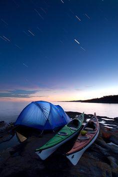 Kayak Camping under star trails near Grand Marais, Minnesota.
