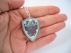 Legend of Zelda Hylian Shield Necklace by ~beautboutique on deviantART